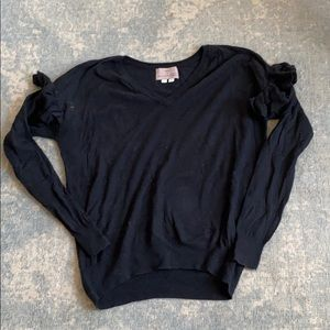 Black Anthropologie sweater with ruffle sleeves
